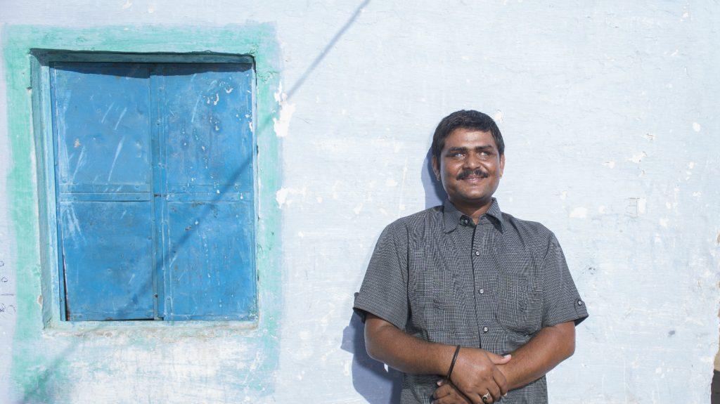 Sankarlal smiles in the sunshine.