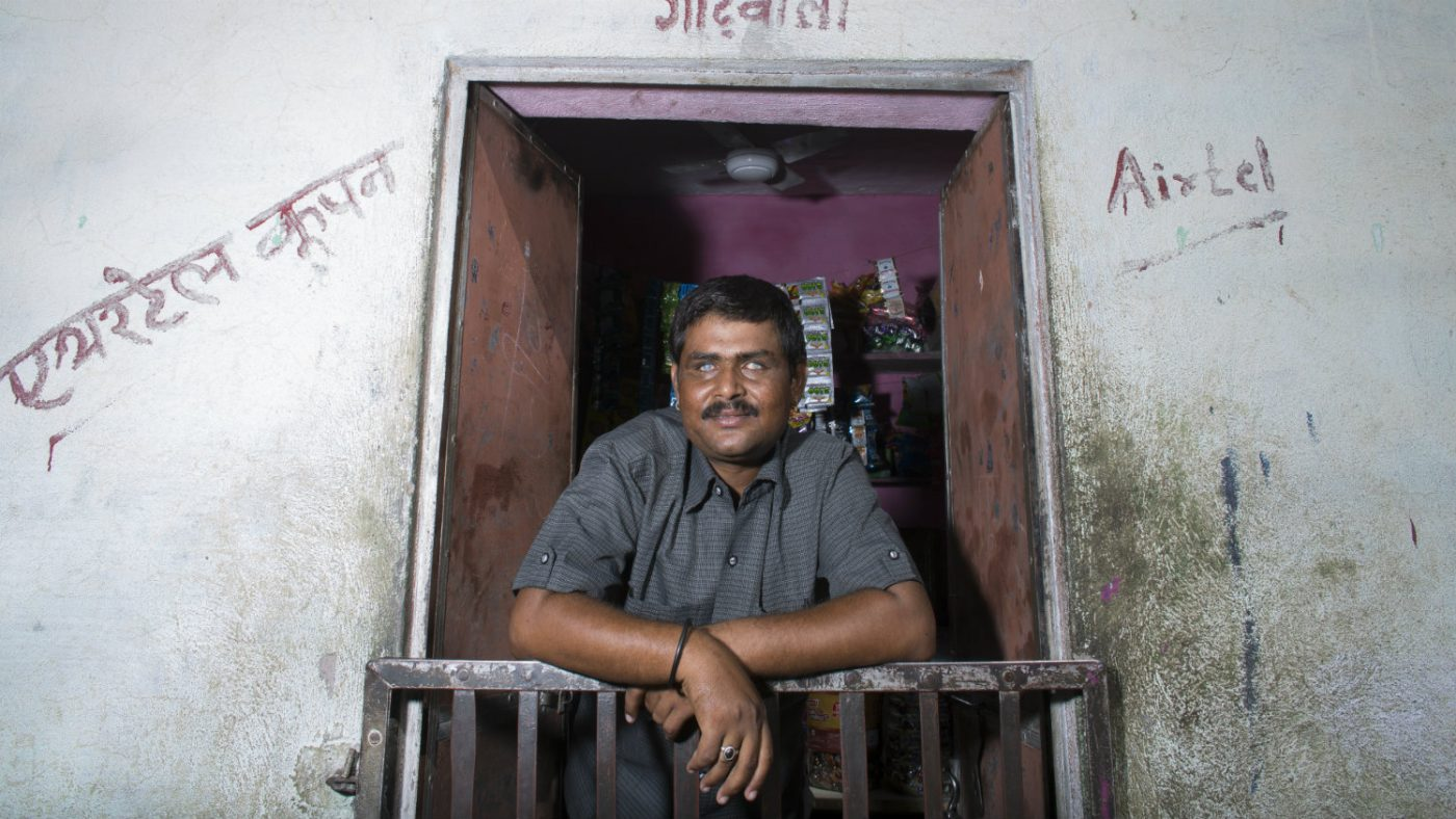 Sankarlal standing in front of his shop.
