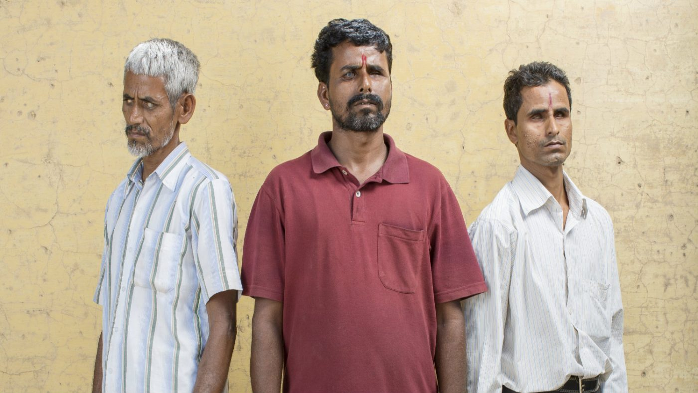 Shyam with two of his brothers, who are also blind.