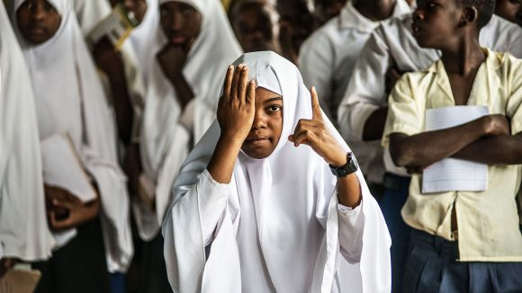 A young girl gets her eyes screened in school.