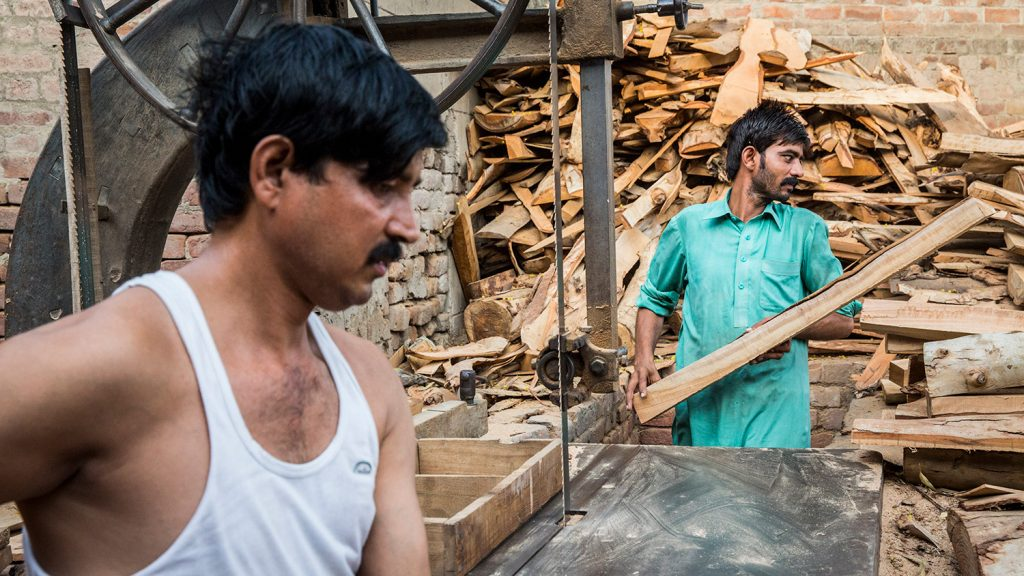 Murtaza is able to work again, and stands in the work place with his brother.