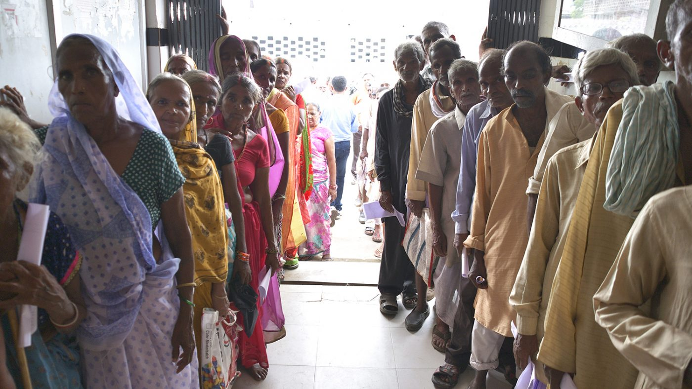 Patients queue up to wait for eye screening in Bihar.
