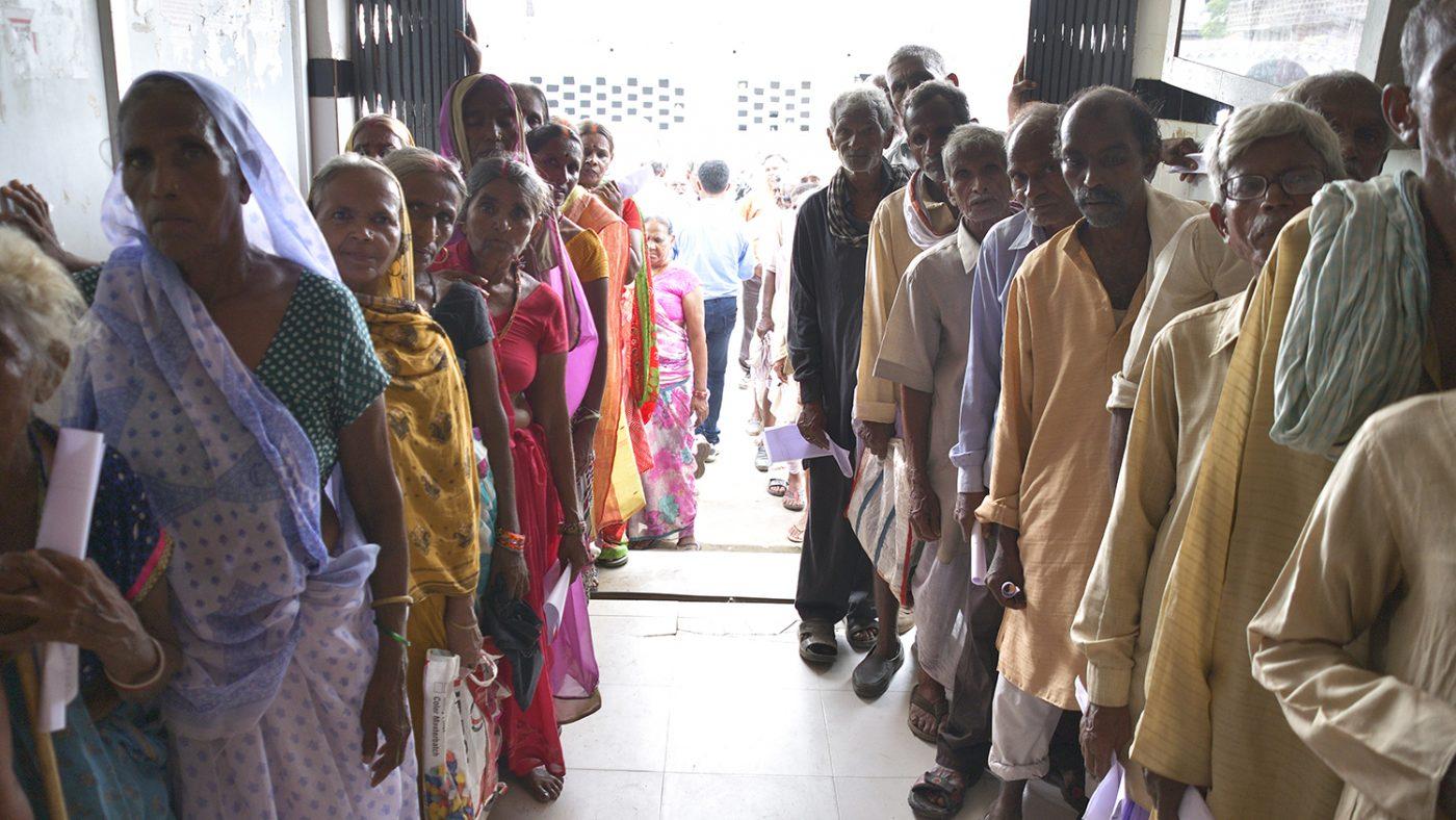 Patients queue up to wait for eye screening in Bihar.