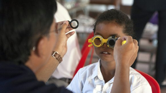 Pouk Sreyneth has her eyes checked as part of the SHIP project.