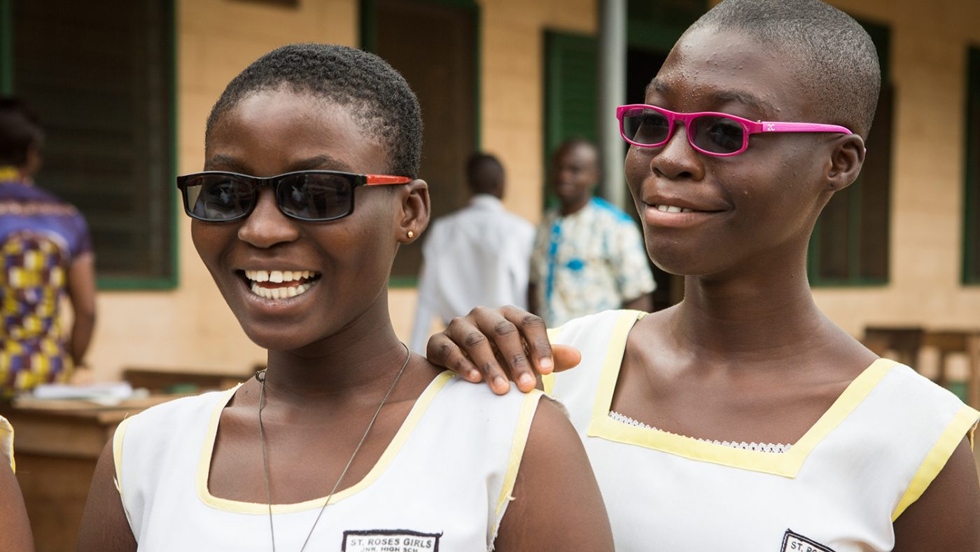 Students from St Roses Junior High School in Ghana show off their new spectacles.