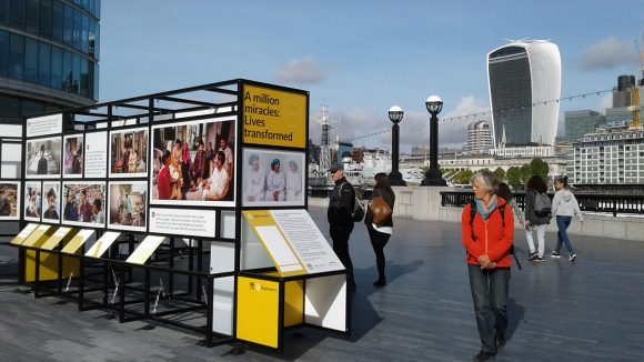 A view of the photo exhibition, with the London skyline in the background.