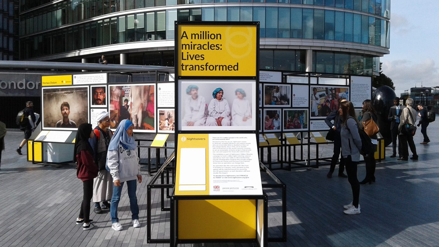 A close-up of one of the exhibition boards, featuring the words: 'A million miracles: lives transformed'.
