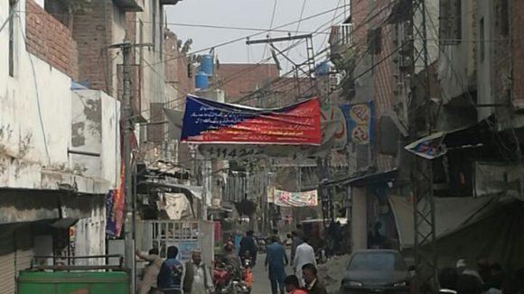 A street in an urban slum in Lahore.