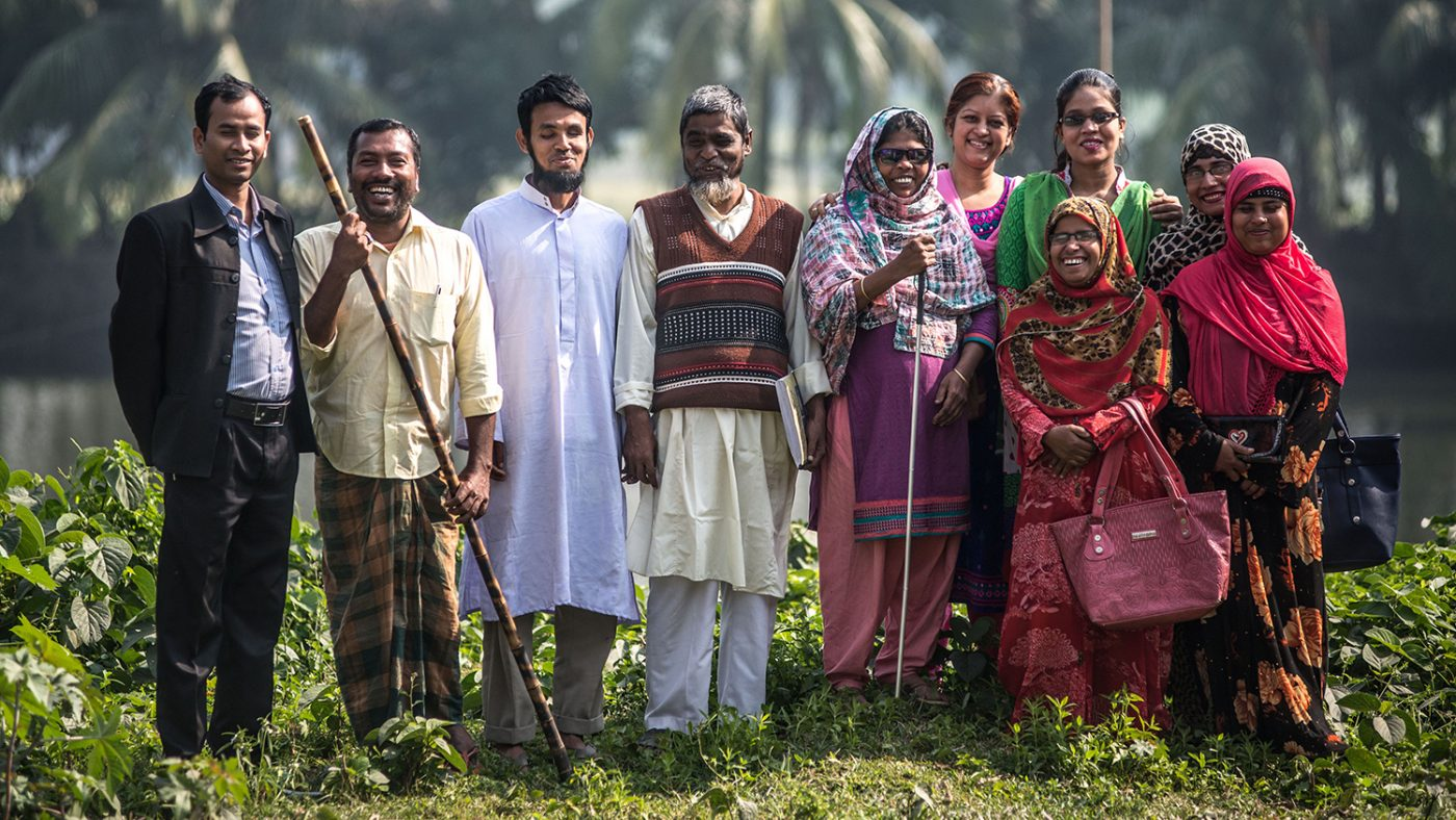 The leaders of disability self-help groups in Bangladesh pose for a photo.