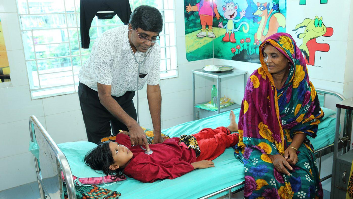 Dr Salam checks on Suborna.