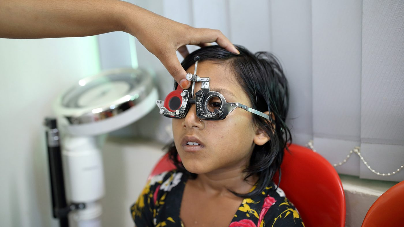 Suborna has her eyes checked.
