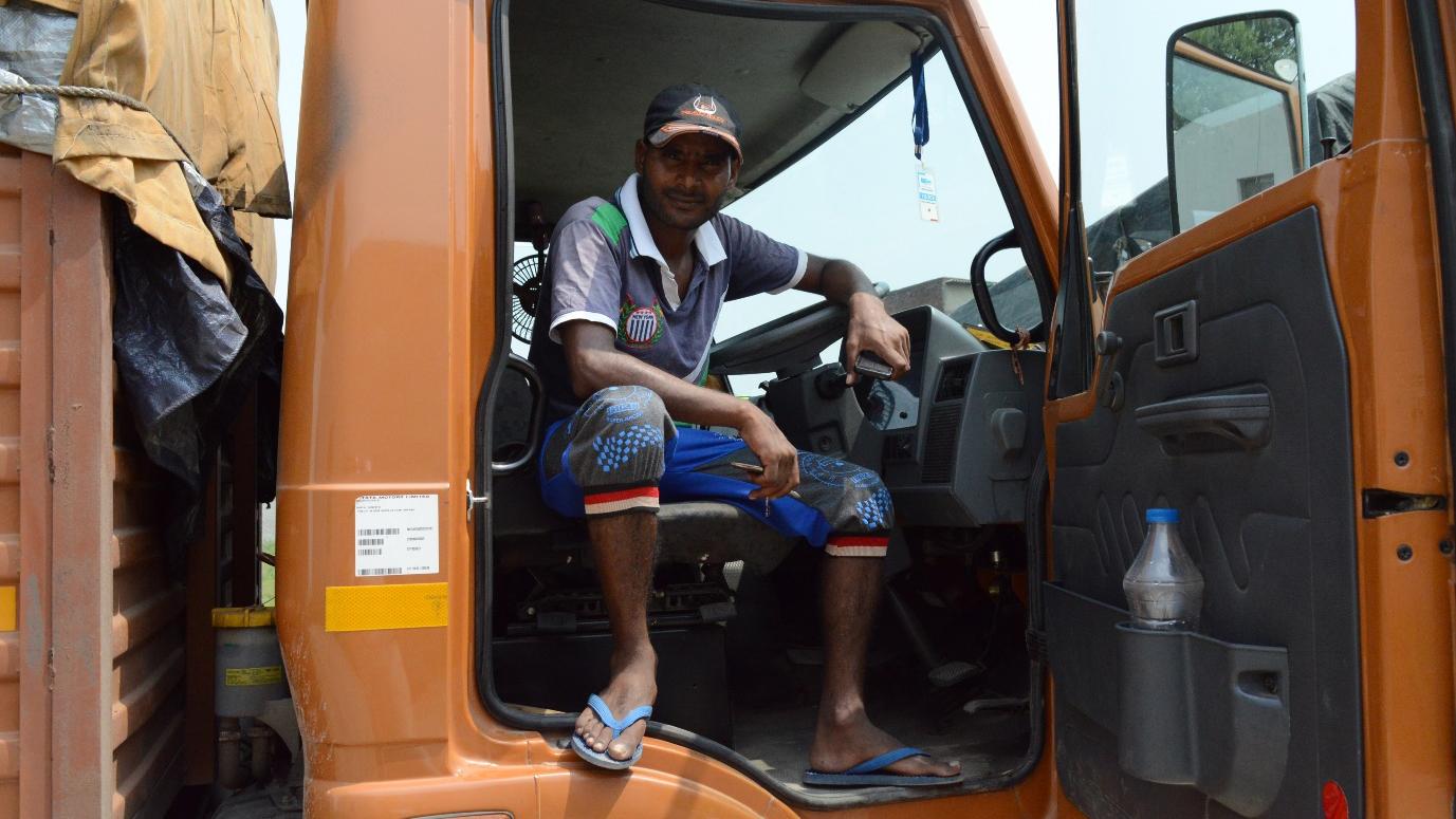 Mohammad Islam Ansari, a young truck driver in New Delhi.