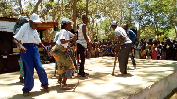 A group of dancers some with walking sticks.