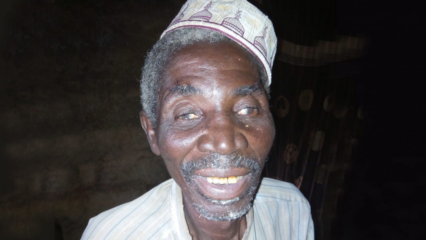 Mr Sadeka Amadou smiling at the camera with a beige hat on.
