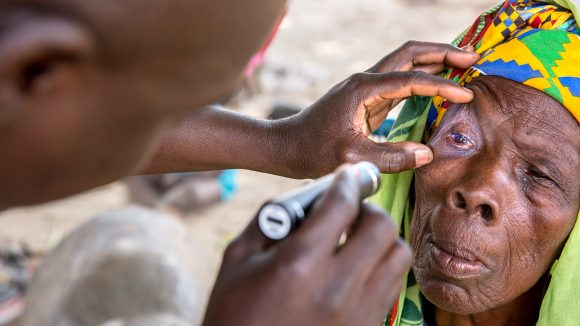 Sayon being examined by a Sightsavers health worker in Mali.
