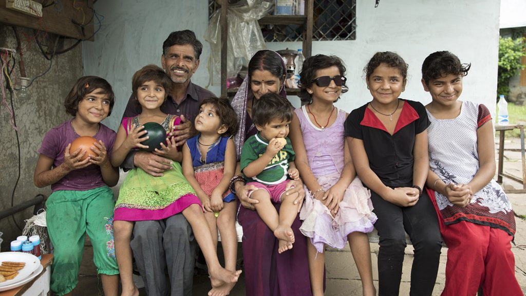 The Yadav family from Bhopal in India, outside their home following their daughter's sight-saving cataract surgery.