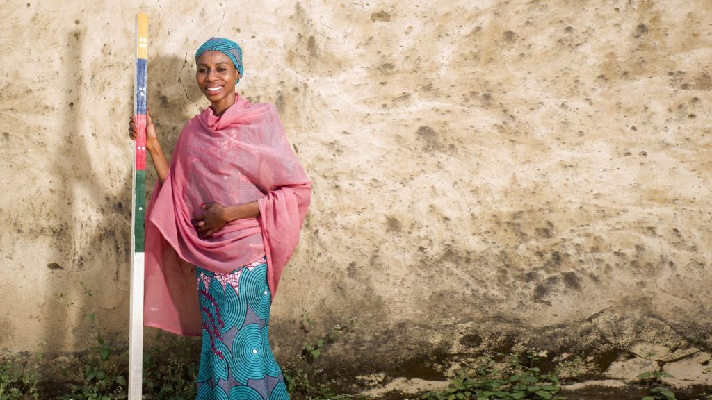 Baraka Ango standing in Nigeria with a dose pole.