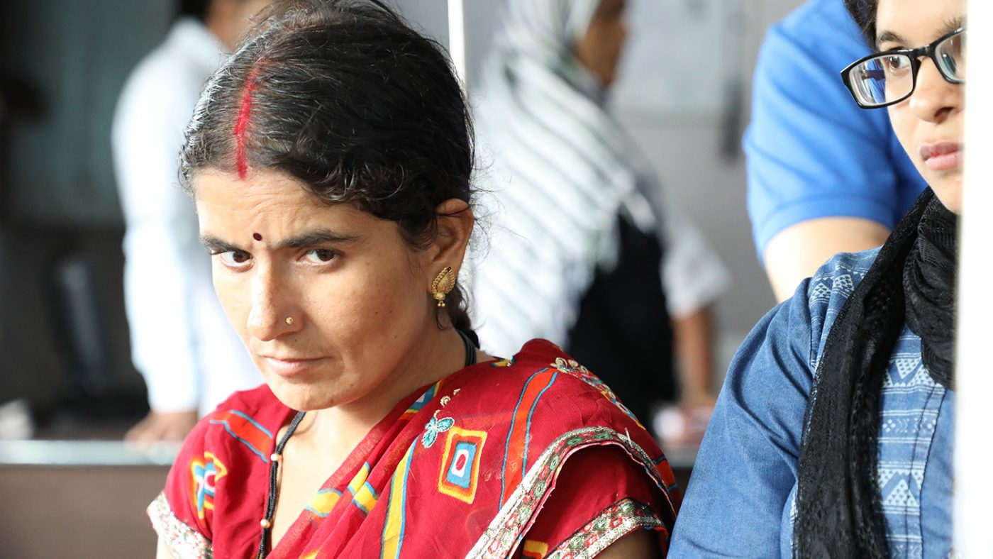 Chandrakala sits alone looking deep in thought.