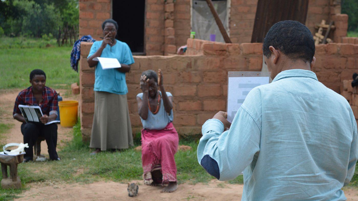 Inuto Mweemba assisting Dr Tesfaye Adera with eye tests.