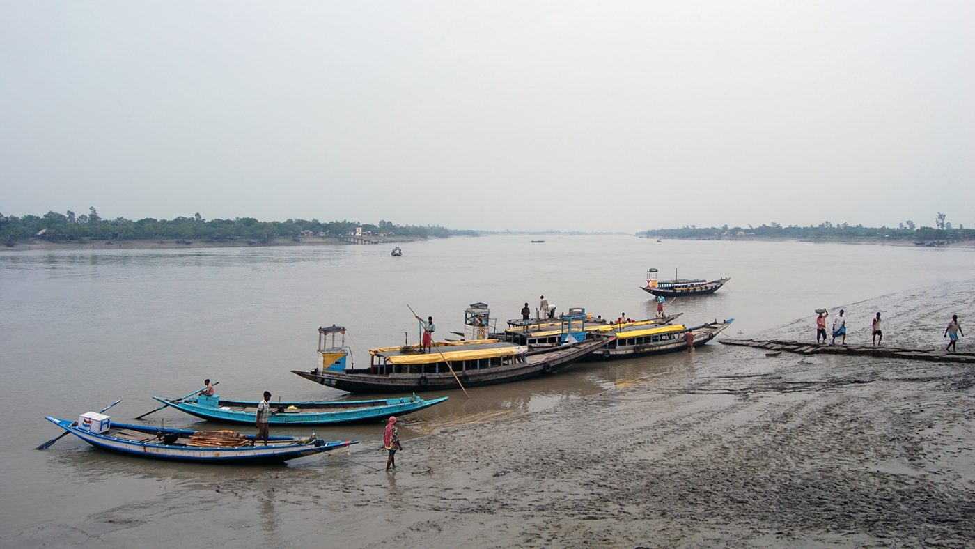 Boats on the river in the Subdarbans in southern India.