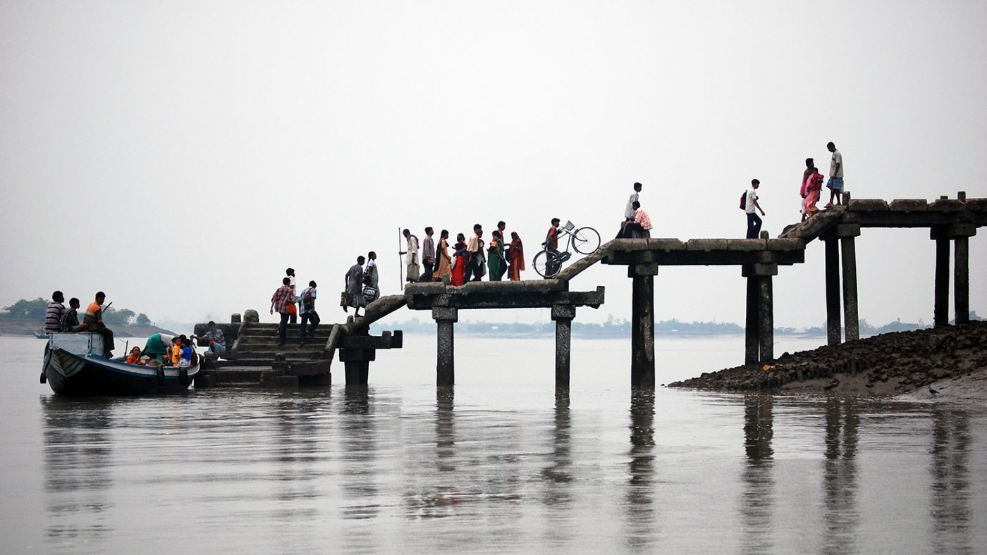 People line up along a jetty in the Subdarbans in southern India.