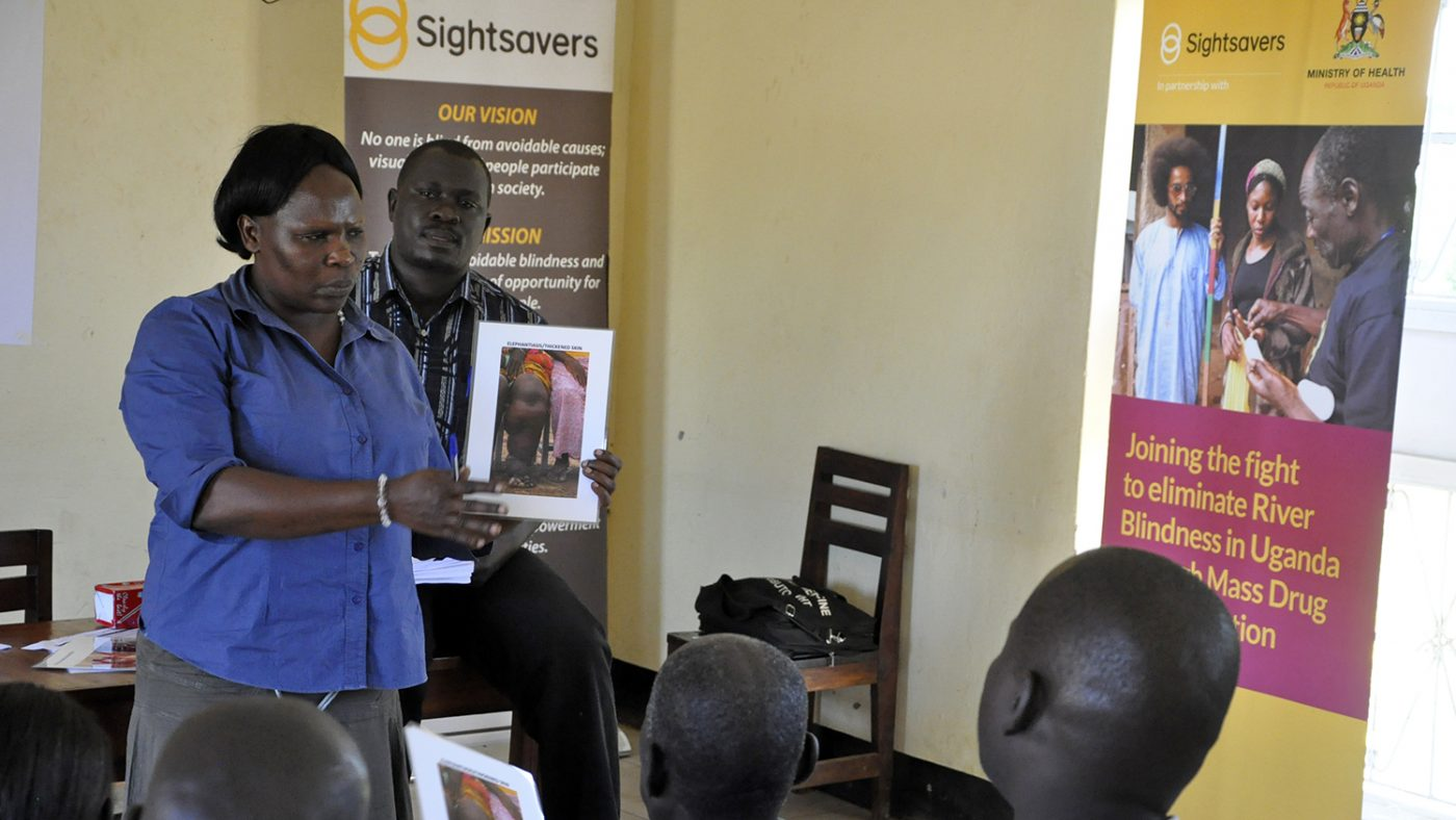 Volunteers in Uganda take part in a training course.