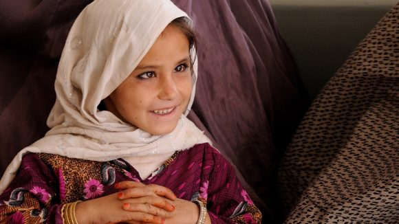A child patient in LRBT Hospital, Pakistan. She is smiling.