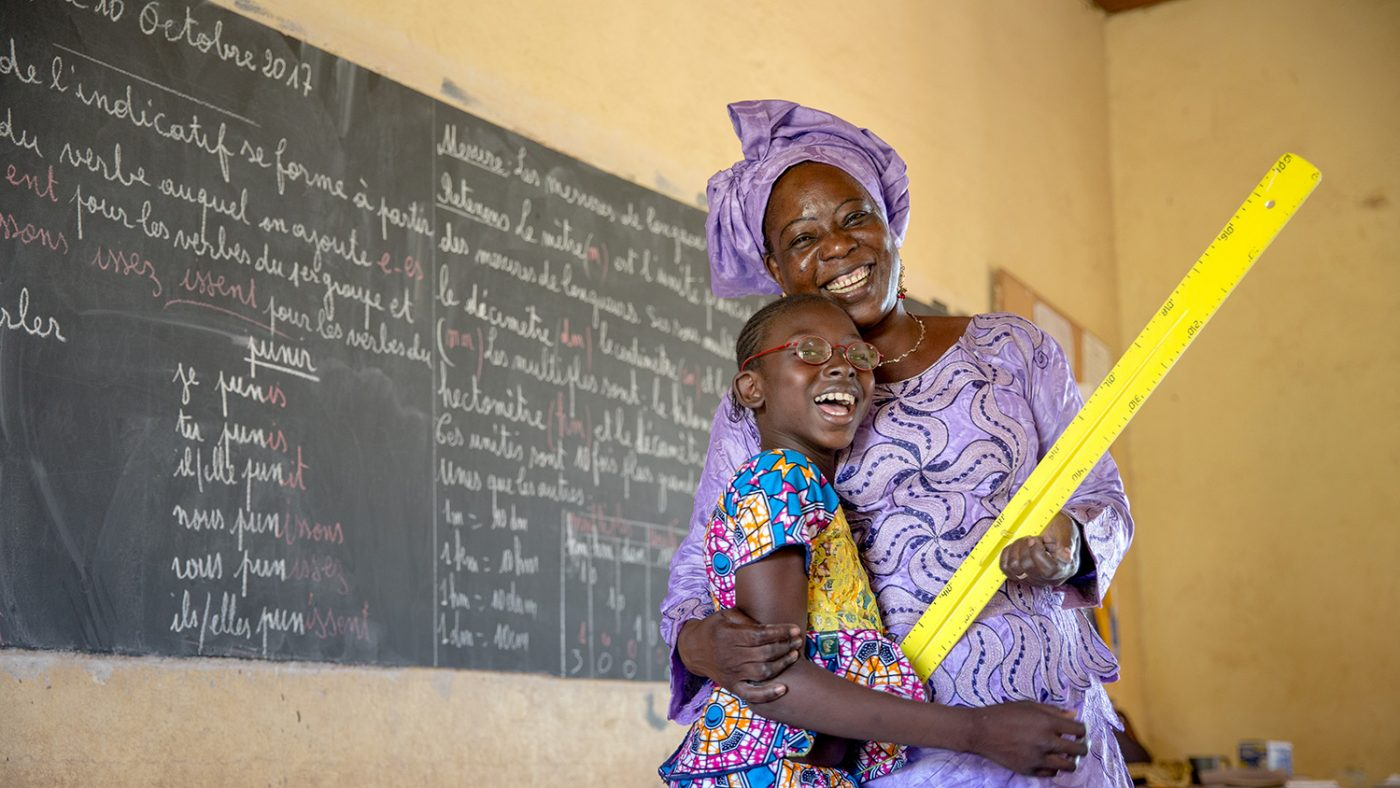Mafoune from Mali with her teacher.
