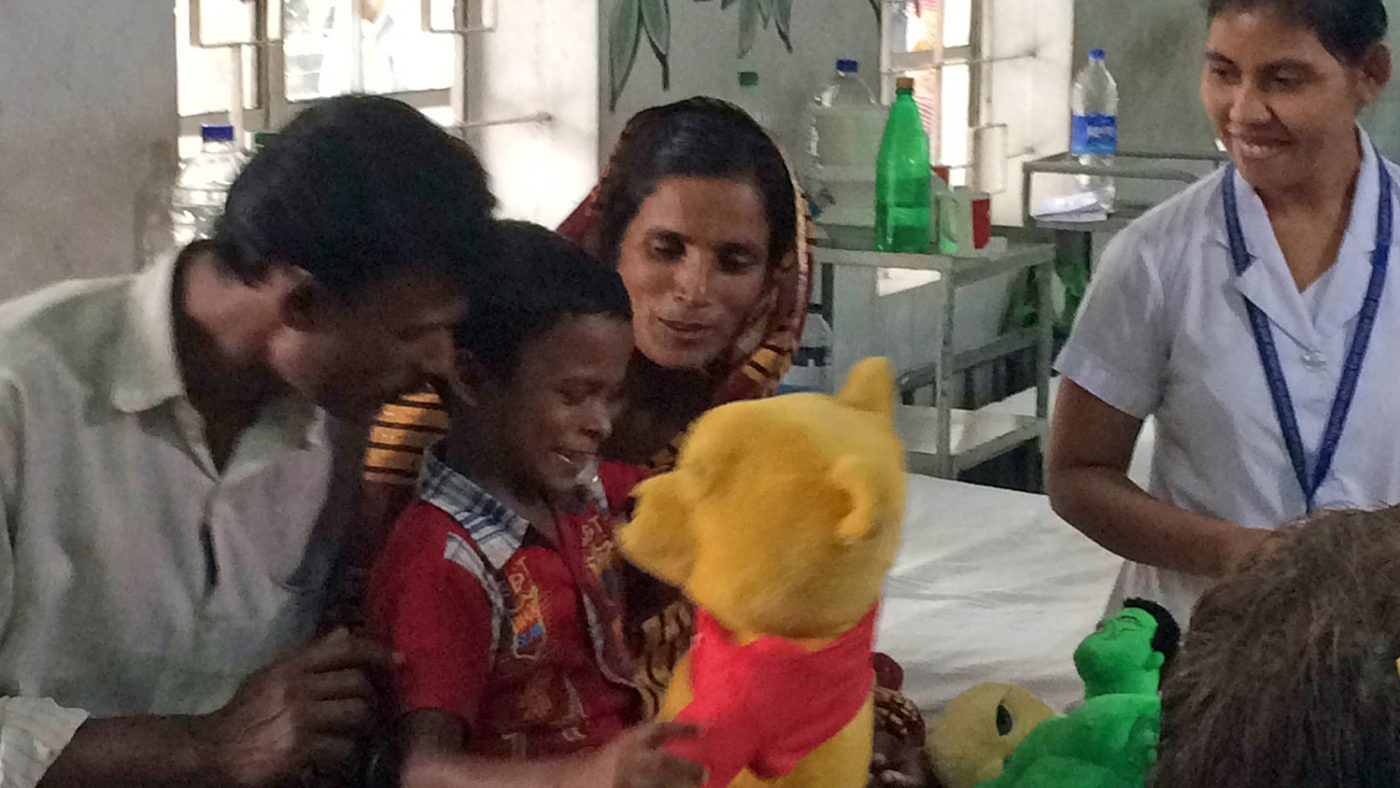 After his cataract operation, Majidul smiles at a cuddly toy.