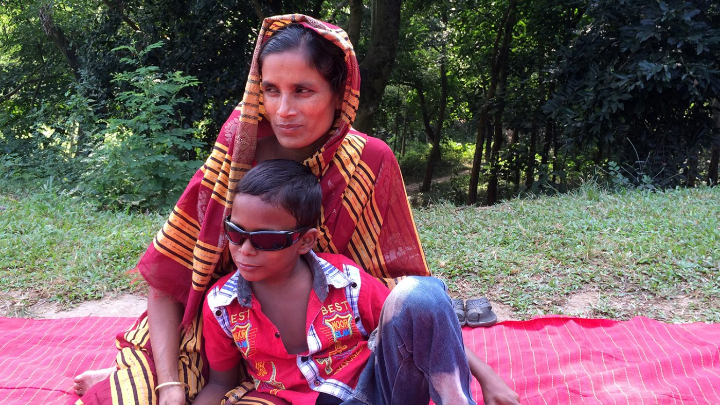 Majidul sits with his mother.