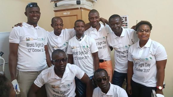 Staff from Makeni Hospital's eyecare team smile for the camera.