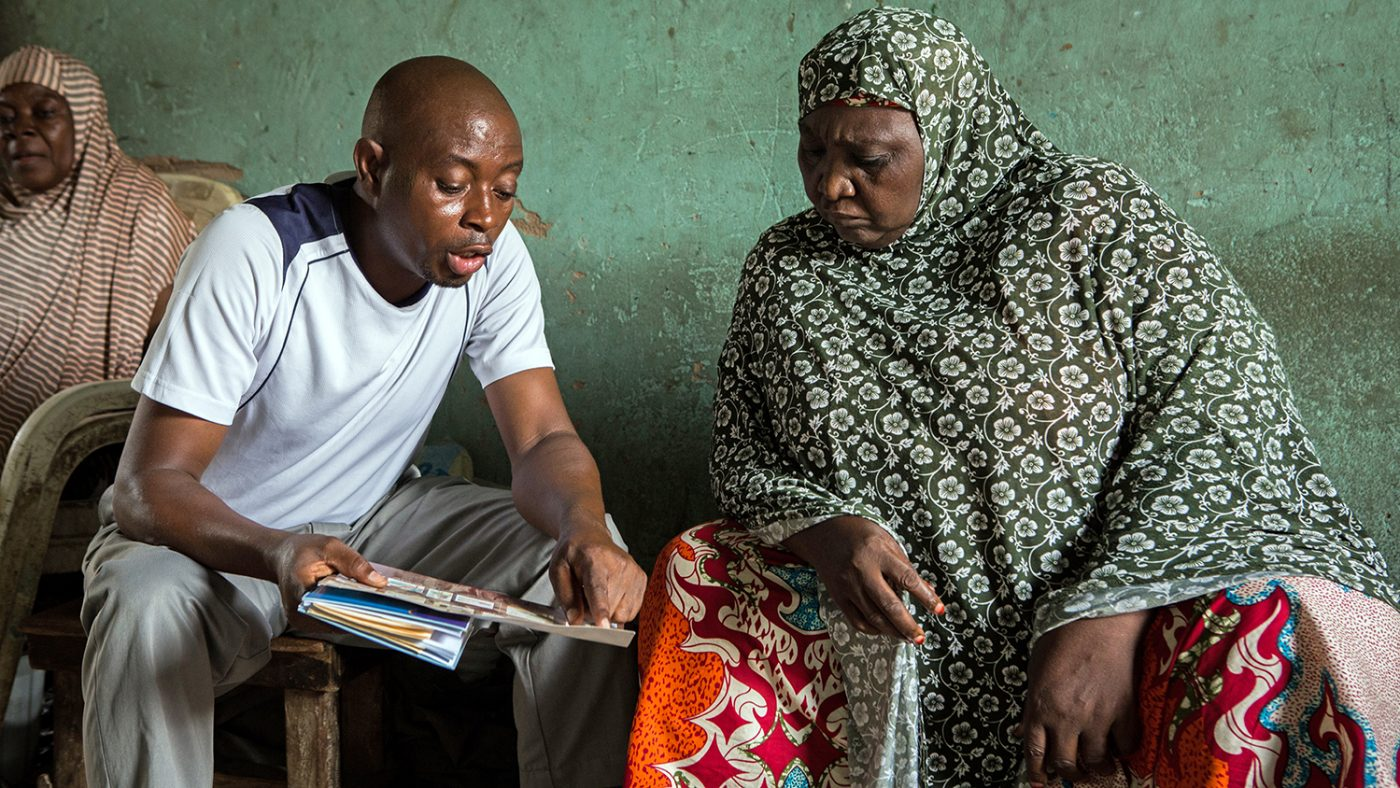 A health worker talks to an LF patient.