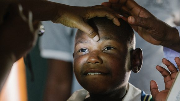 Eight-year-old Mohammed has his eyes screened.