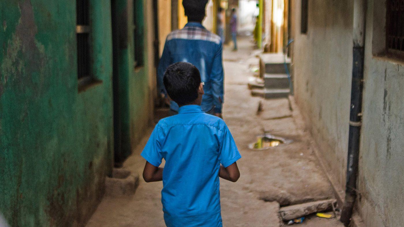 Shahid walks along the streets of Patna.