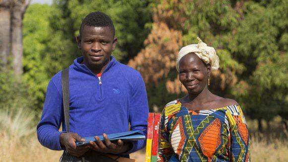 Two drug distributors, a male and a female, in Burkina Faso.