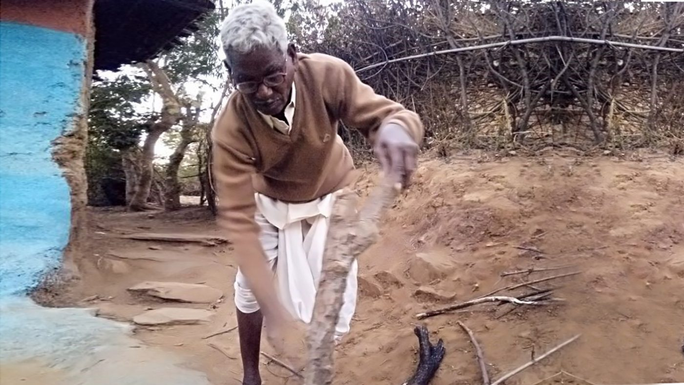 Sevaram from India chops wood after returning to work following his cataract surgery.