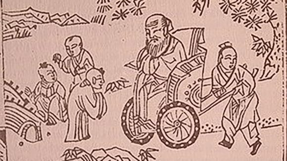 An ancient Chinese artwork featuring a man being wheeled in a chair.