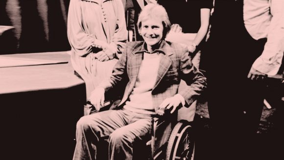 Actor Roger Tonge on set at Crossroads, sitting in a wheelchair.