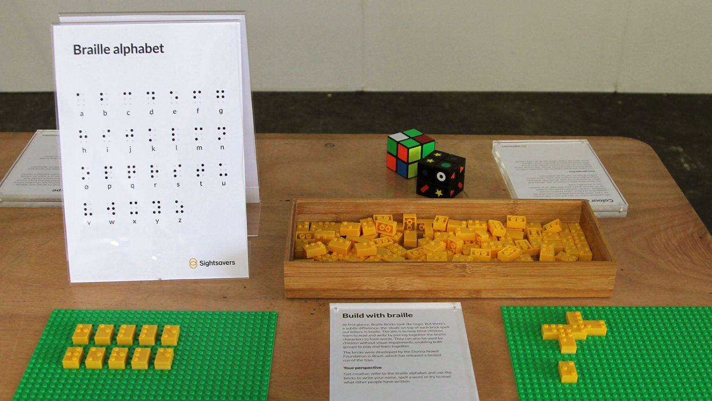A close-up of a box of Braille Bricks on Sightsavers' stand.