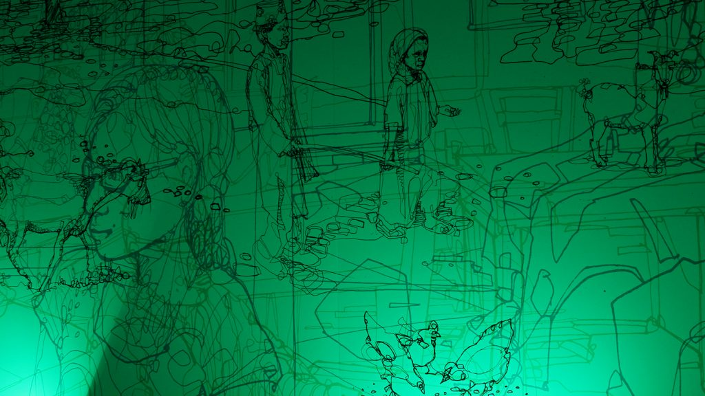 A view inside Sightsavers' colour room at the D&AD festival. The light in the room is switched to green, revealing an illustration on the wall.