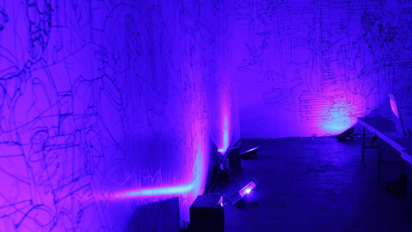 Inside the colour room on Sightsavers' stand: the room is bathed in blue light, revealing an illustration on the wall.