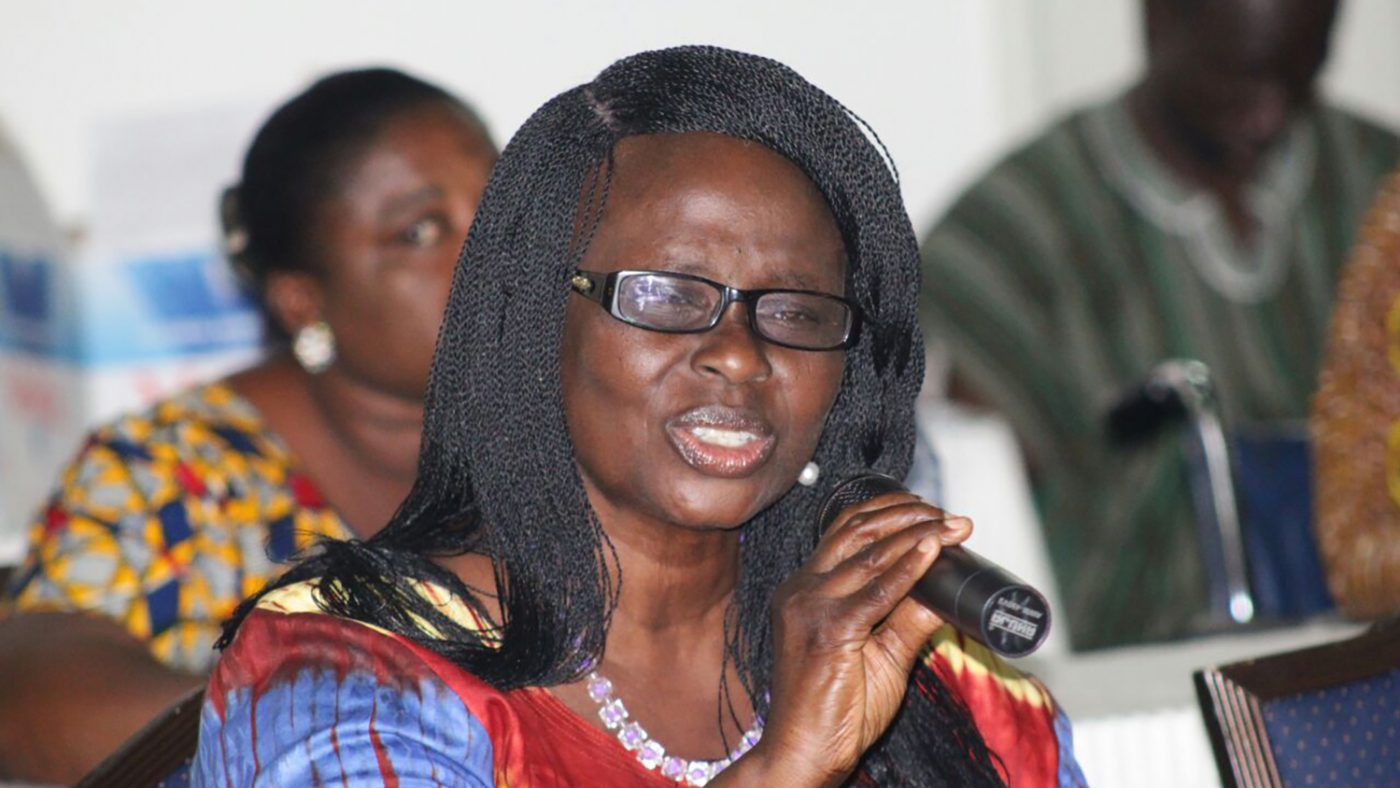 Gertrude Oforiwa Fefoame speaking into a microphone at an event.