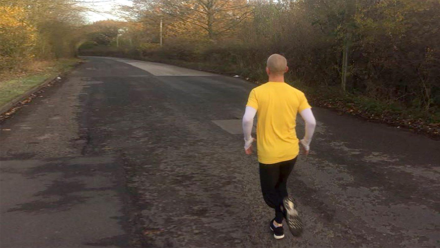Ben runs down a country road.