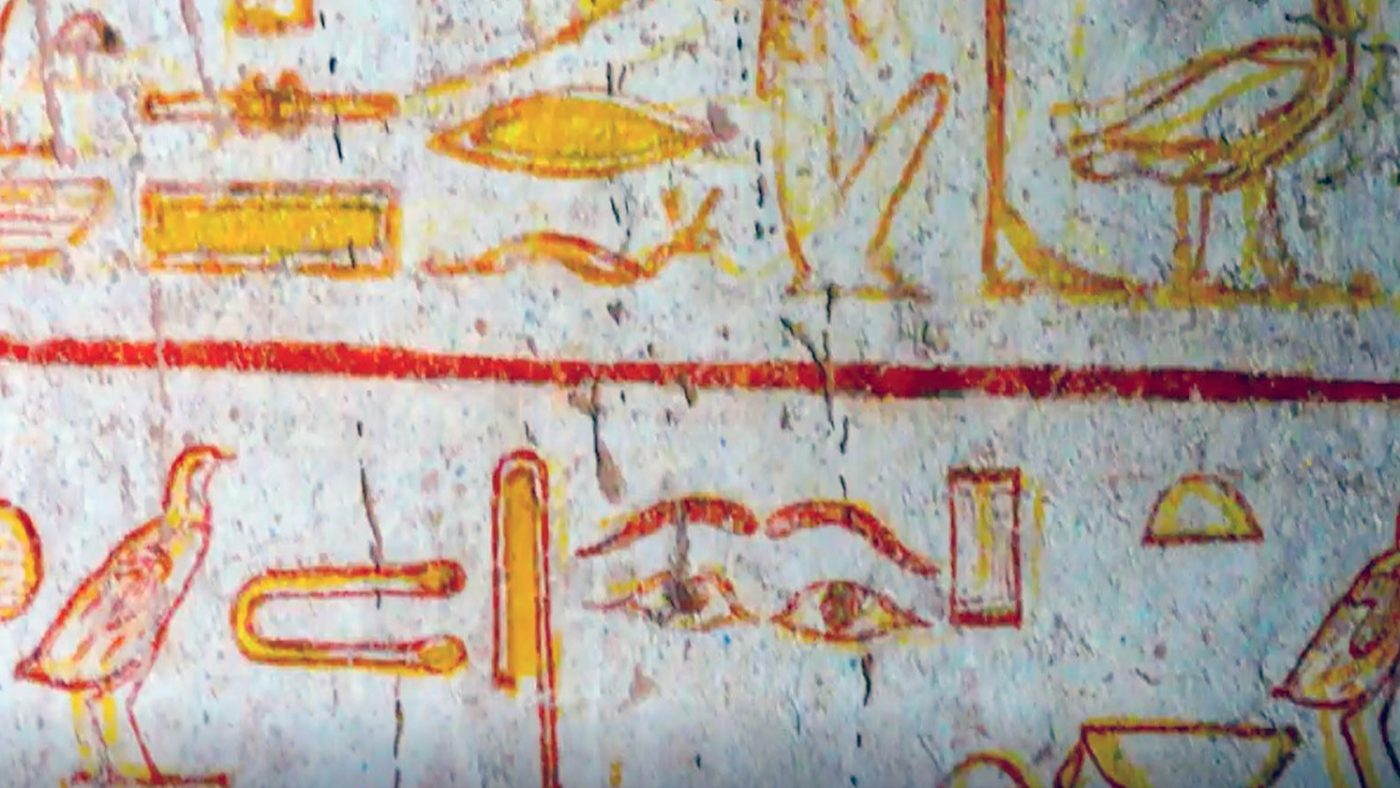 An ancient painting from a tomb showing hieroglyphics, including eyes and tweezers.