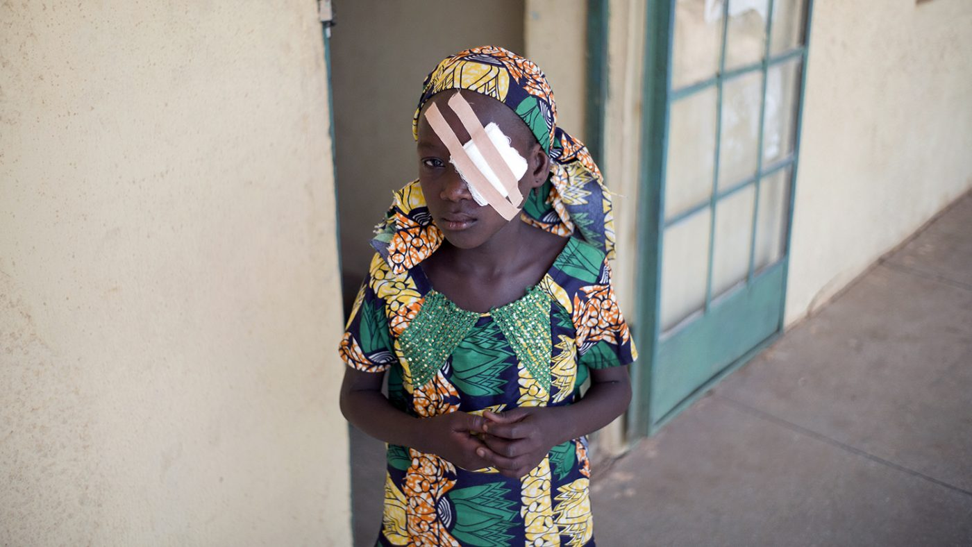 Trichiasis patient Maryam Abubakar after trachoma surgery, with a patch on her eye.