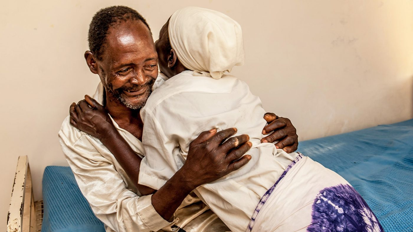 Winesi March and his wife embrace at the joy of his sight being restored.