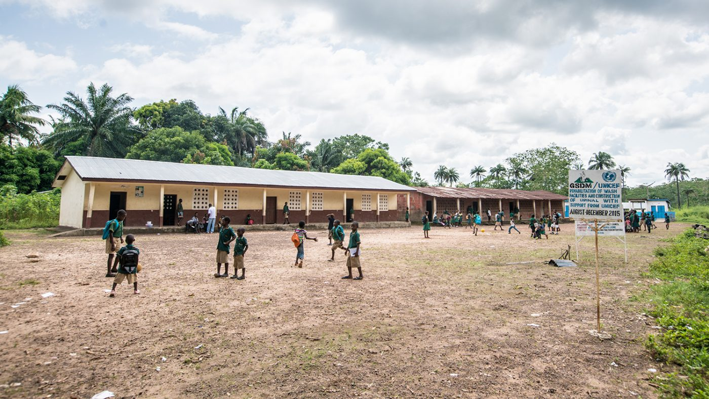Students from the school play outside.