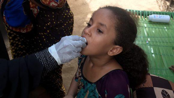 A child receives medicine in Yemen.