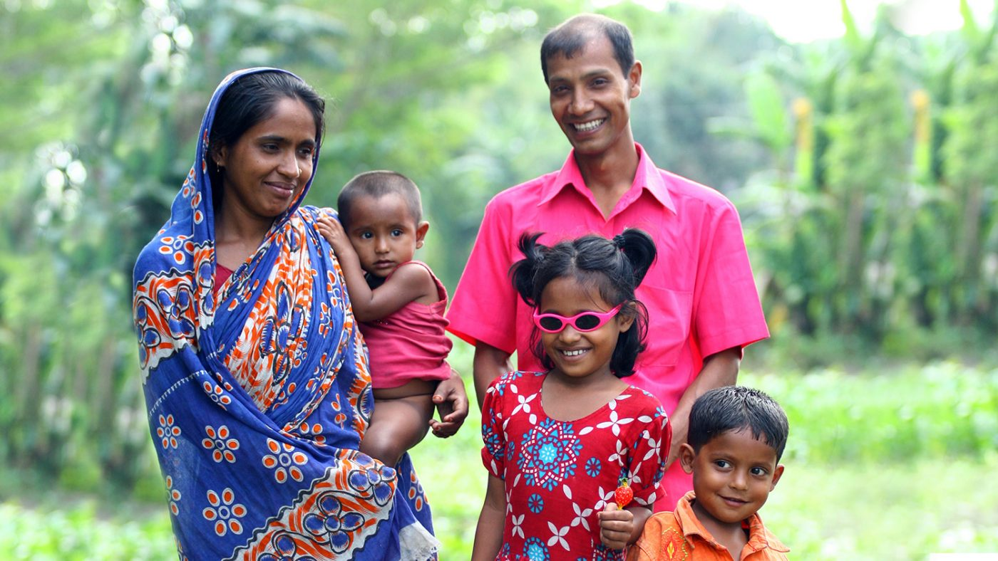 Smriti stands proudly in her new pink sunglasses, with her family around her.