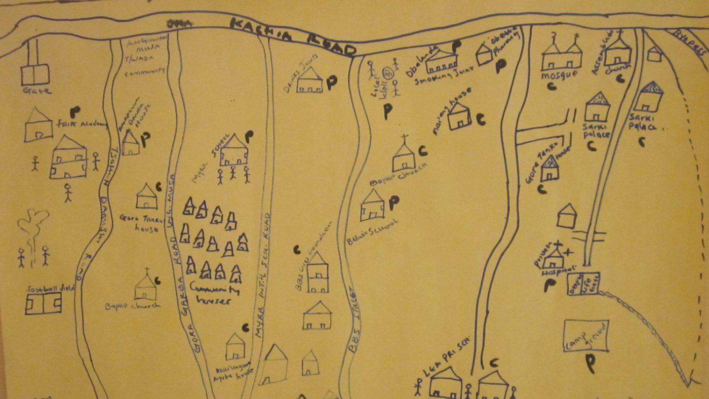 A hand-drawn map showing buildings and roads.